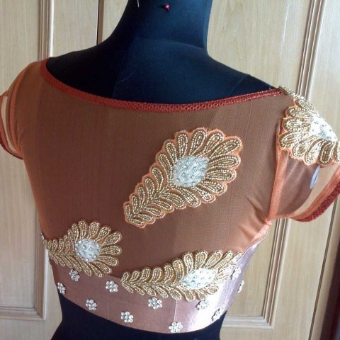 Have a look at some of the boat neck blouse designs or patterns here.